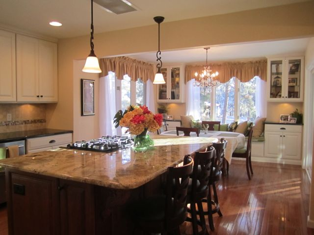 Kitchen Remodel with hardwood floors granite stainless steel and semi-custom cabinetry from HappyandBlessedHome.com