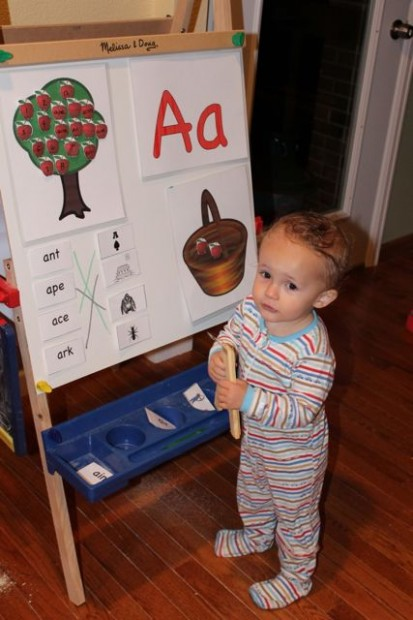 An easel is the perfect backdrop for early childhood education and preschool activities