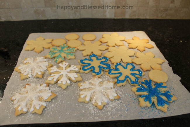Add V on ends and then add sprinkles to create Snowflake Cookie Recipe and Cookie Decorating Tutorial HappyandBlessedHome.com
