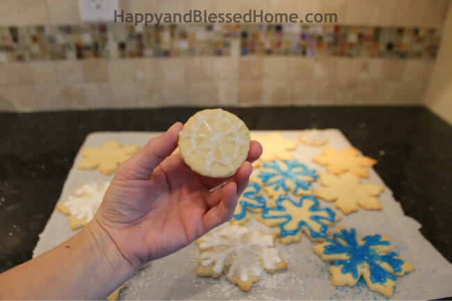 Draw a snowflake on a round cookie to create the Snowflake Cookie Recipe and Cookie Decorating Tutorial HappyandBlessedHome.com