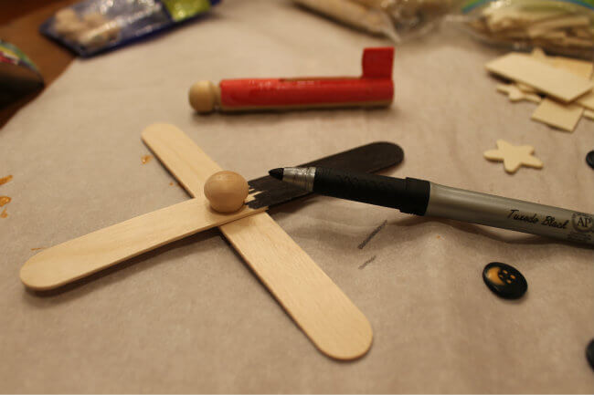 Use Markers as needed to color plane parts for this DIY Model Dinsey Planes from HappyandBlessedHome.com