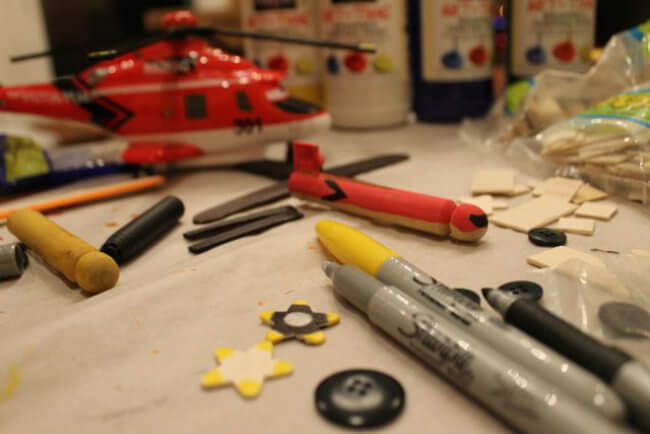 Using markers for finer details in DIY Model Disney Planes from clothespins HappyandBlessedHome.com