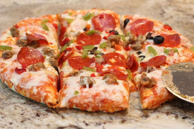 Trim up Supreme Pizza into Triangles