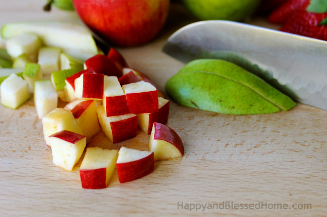Cutting Fruit for Marie Callender's Pot Pie and my Favorite Apple, Pecan, Fruit and Nut Salad from HappyandBlessedHome.com