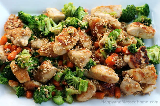 Honey Lemon Chicken Recipe with broccoli, carrots and sesame seeds from HappyandBlessedHome.com