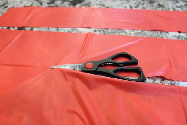 Cut the tablecloth into strips - keep it folded in half for thickness