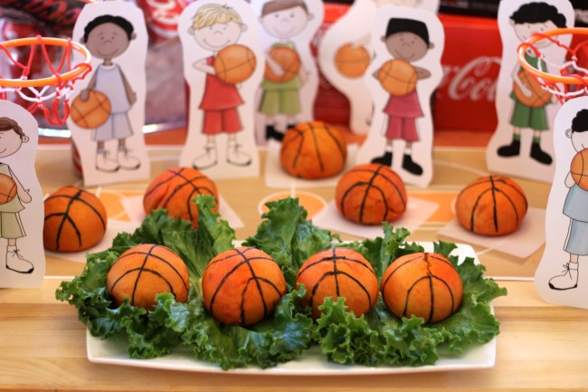Basketball Party Appetizer Recipe Sausage and Cheese Stuffed Pretzel Balls decorated to look like basketballs from HappyandBlessedHome
