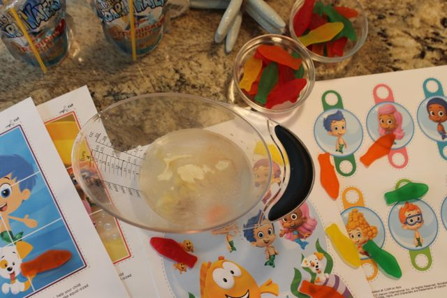 Gelatin added toCapri Sun Roarin' Waters to create Bubble Guppies Jello Recipe from HappyandBlessedHome.com