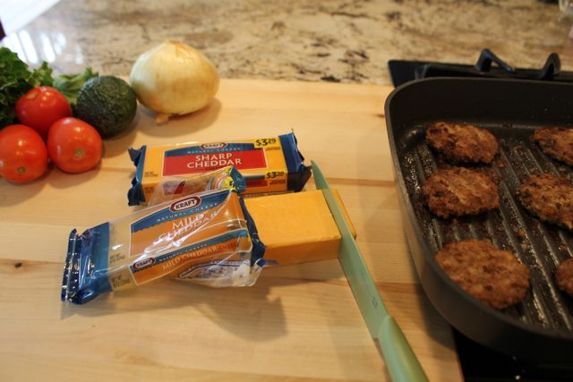 Cut a hunk of cheese off a Kraft cheese bar to top the slider patty