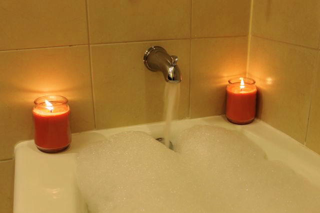 Run a bubble bath with warm water and candles
