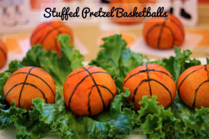Stuffed Pretzel Basketballs Recipe with Sausage and Cheese stuffed Preztel Balls decorated to look like basketballs from HappyandBlessedHome.com