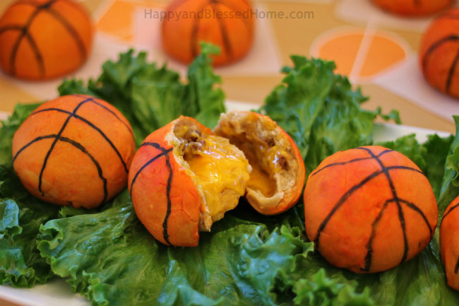 These Sausage and Cheese Stuffed Pretzel Basketballs make the perfect Basketball Party Appetizer from HappyandBlessedHome.com