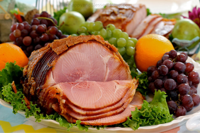 Use fruit to decorate your Easter table and enjoy HoneyBaked Ham and sides from HappyandBlessedHome.com
