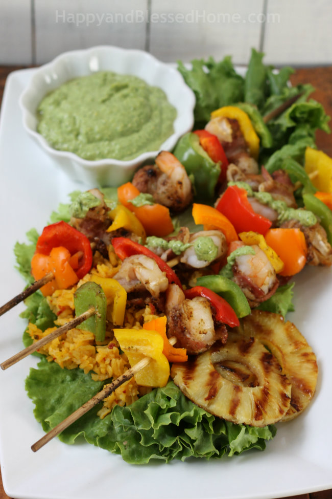 Perfect for the summer grill! Coffee rubbed bacon wrapped shrimp skewers with cilatro pesto HappyandBlessedHome.com
