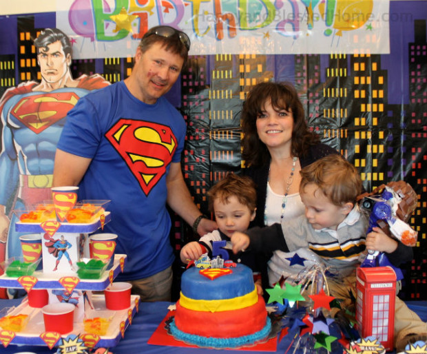 Blowing Out The Candles On His 5 Year Old Superman Birthday Party Cake HappyandBlessedHome