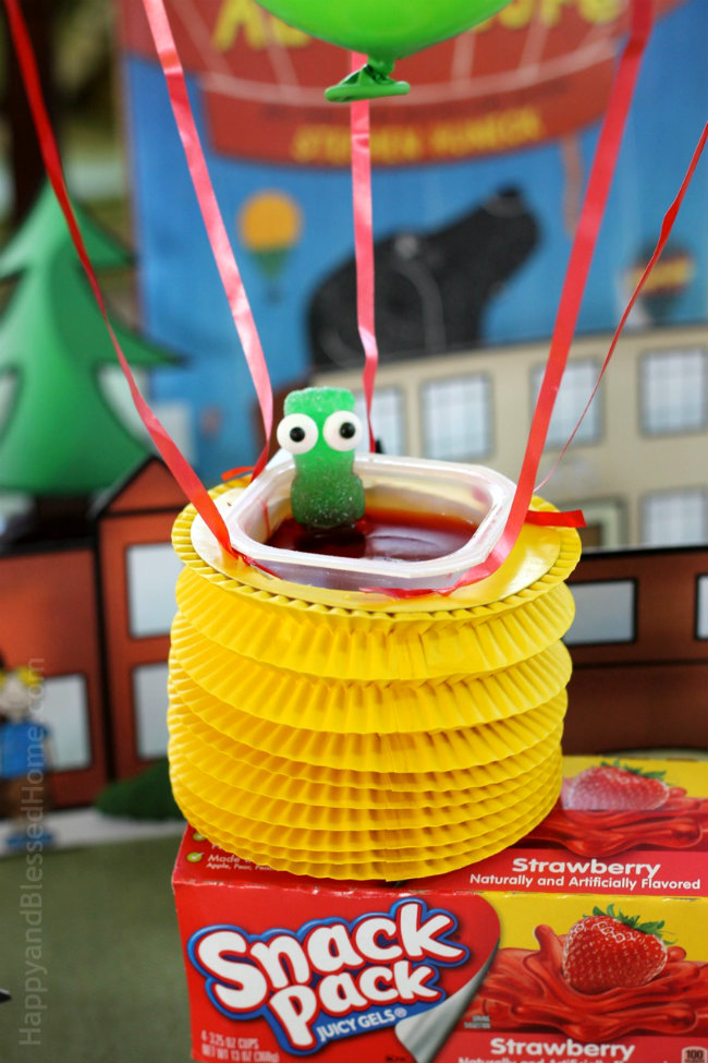 Doubling as a hot air ballloon basket - snack pack juicy gel cup with sour patch kid passenger is ready for take-off - tutorial by HappyandBlessedHome