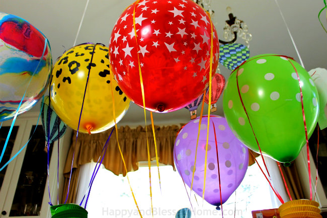 Fanatasy Hot Air Balloon Party using paper lanterns and helium balloons with FREE Balloon Printables from HappyandBlessedHome