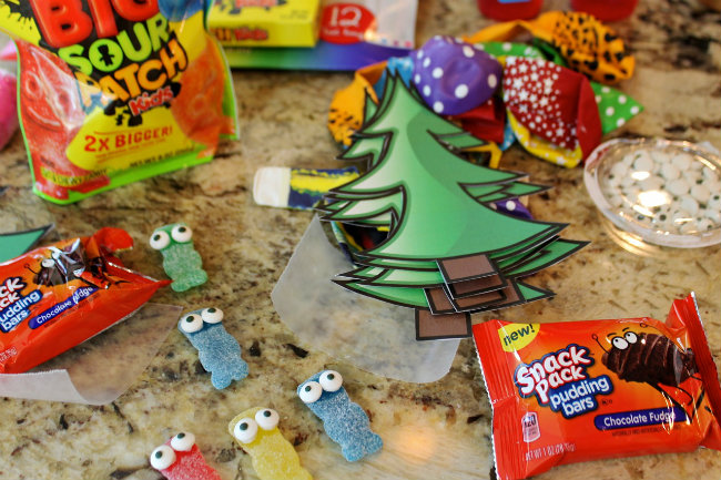Hot Air Balloon craft assembly included adding candy eyes to the Sour Patch Kids - party fun from HappyandBlessedHome