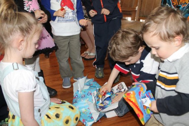 Unwrapping birthday gifts Photo Copyright 2015 HappyandBlessedHome.com