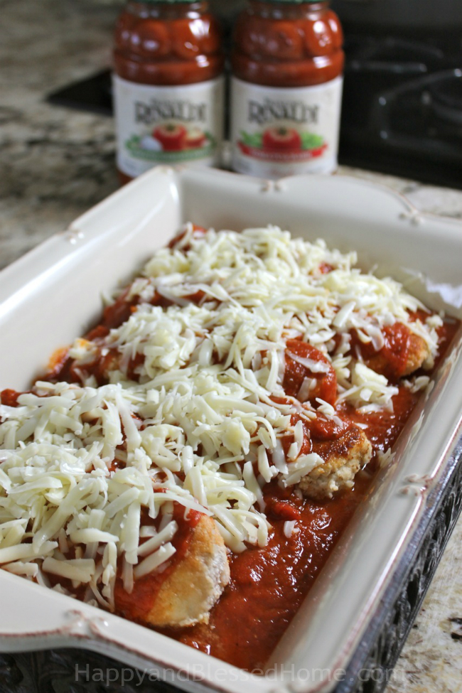 Layer the Francesco Rinaldi marinara sauce over the chicken - Chicken Parmesan recipe from HappyandBlessedHome