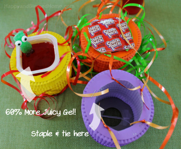 More Juicy Gel and Hot Air Balloon basket assembly - staple and tie each strand of ribbon to the paper lantern - craft tutorial by HappyandBlessedHome