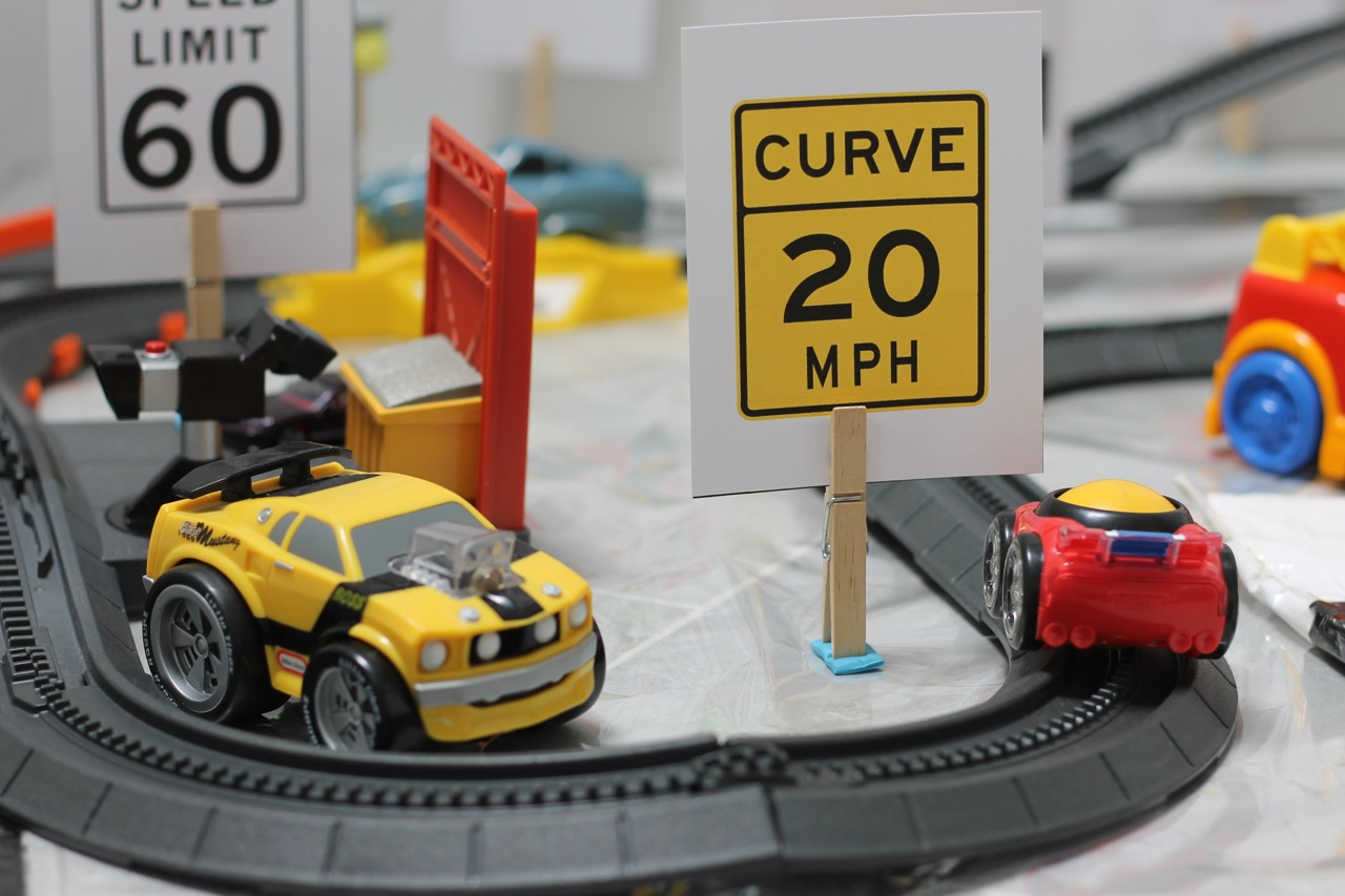 Curves Ahead with DIY Checkered Flag Play Mat for Race Car Fun from HappyandBlessedHome