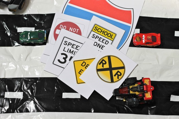 Free Printables and DIY Checkered Flag Play Mat for Race Car Fun from HappyandBlessedHome