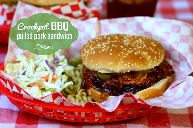 Saucy savory and perfect for your next BBQ - Crockpot BBQ Pulled Pork Sandwich from HappyandBlessedHome