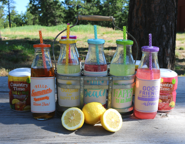 Fun Milk Bottles with Staws and Lids Filled with Country Time Lemonade Mixes with recipe from HappyandBlessedHome.com