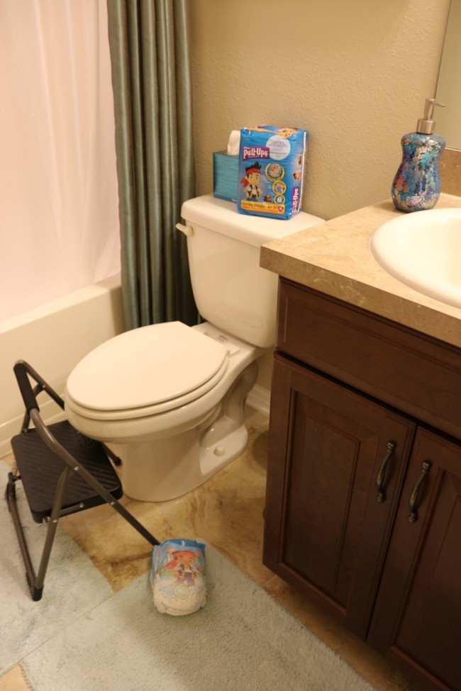 Use a stool and have spare pants ready for nighttime potty training