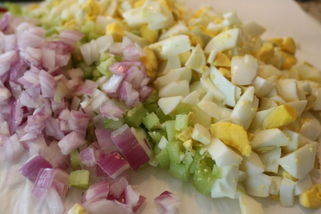 Chop hard boiled eggs celery and red onion for an easy egg salad sandwich recipe