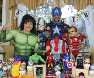 Check out our muscles! Superhero family flexes for the Blu-ray DVD launch of Avengers - Age of Ultron Movie