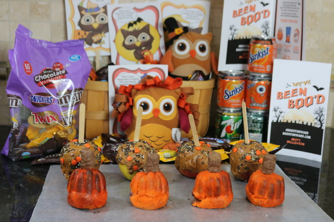 Candy filled mini pretzel pumpkins and caramel covered apples for a Boo It Forward treat