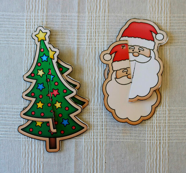 Cut a slit in the top of one piece and a slit in the bottom of the other to crate these Christmas Ornaments
