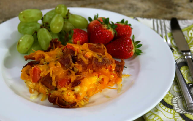 Fresh fruit and a single serving of an easy Hash browns, Eggs and Bacon Breakfast Casserole