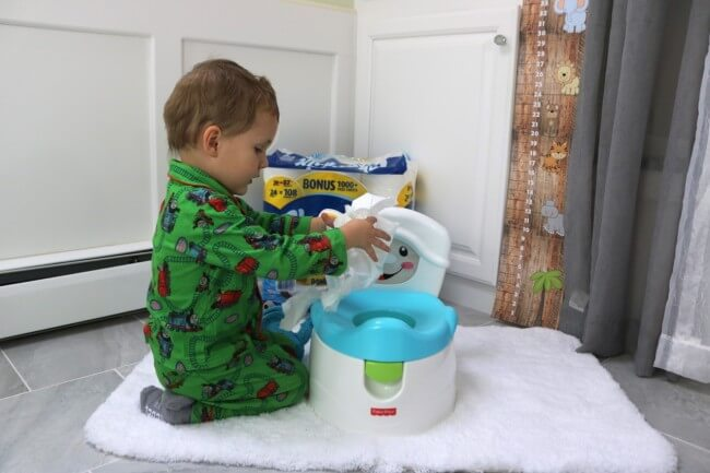 Practice putting the Charmin toilet paper where it needs to go long before letting him try to potty on his own