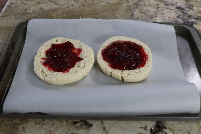 Fill both halves of the scone dome with raspberry pie filling