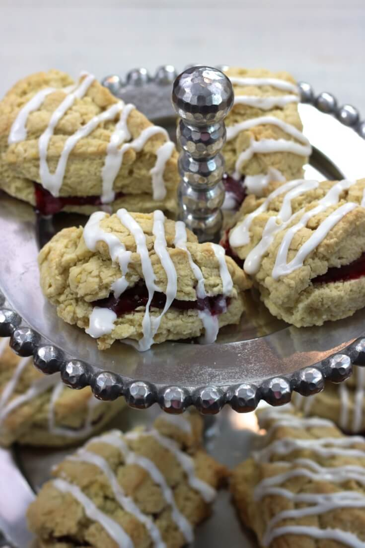 Re-assemble the two halves and squeeze some cookie icing onto these Raspberry Scones