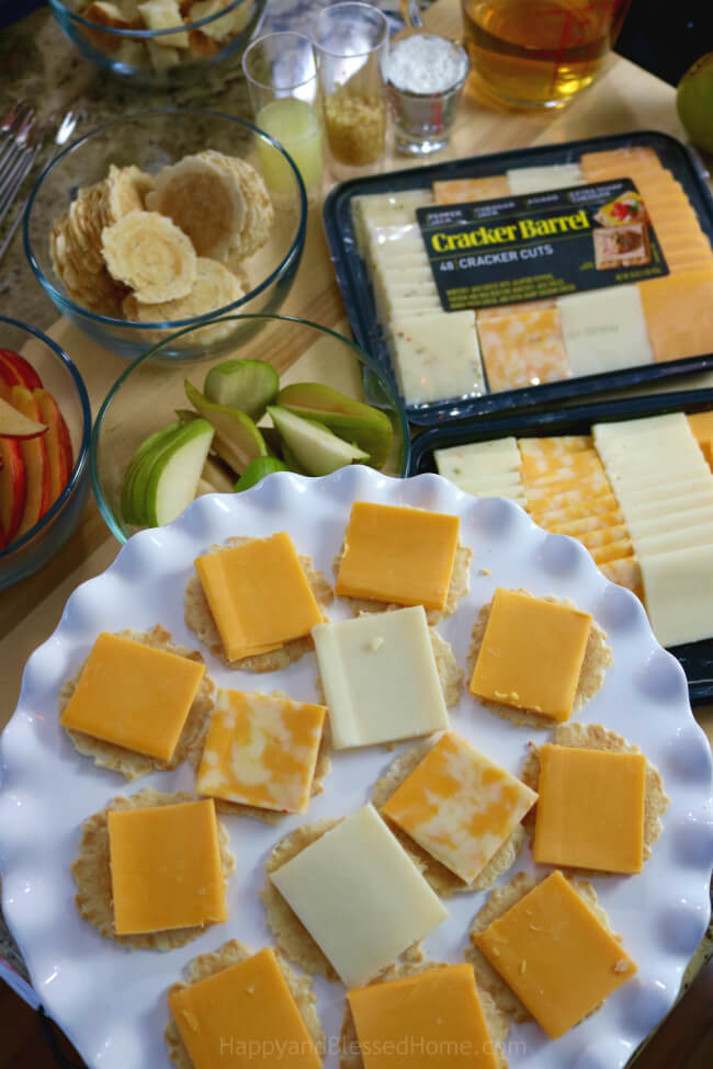 An easy recipe for a festive and flavor-filled cheese tray from HappyandBlessedHome.com