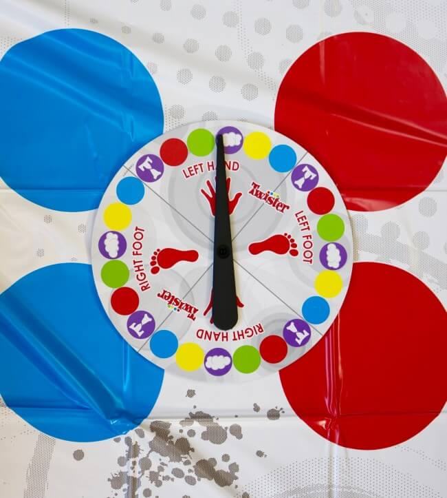 Twister dial with directions to move arms and legs
