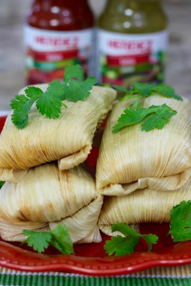 Wrapped in corn husks and steamed to perfection - Shredded Chicken Tamales