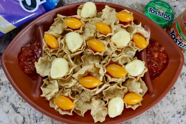 A game day snack perfect for hungry football fans with Tostitos chips, salsa and football shaped cheese