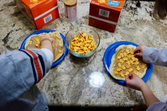 Simple hand made flat bread sandwiches with Goldfish crackers makes for memorable kid fun
