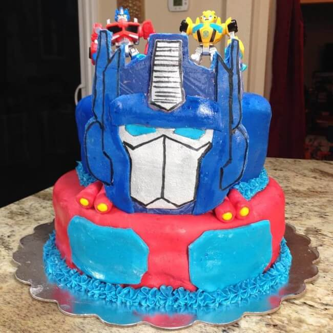 Optimus Prime Cake created in chocolate and fondant for a child's Rescue Bots Birthday Party with Transformers