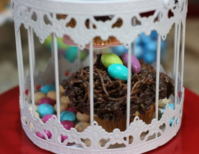 "Caged nest as part of An easy recipe for Lemon Poppyseed Muffins and Chocolate Nests & tips on how to ""float"" birds above the nests with M&M's® Easter candies."
