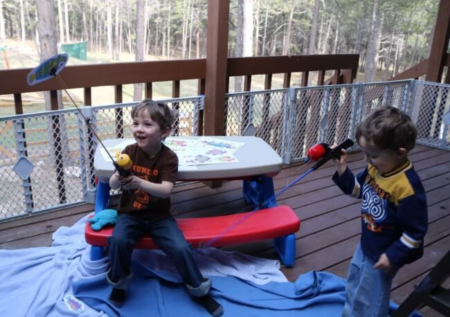 Our boys enjoying the Go Fish Activity Pack for Kids with 10 Fun Activities