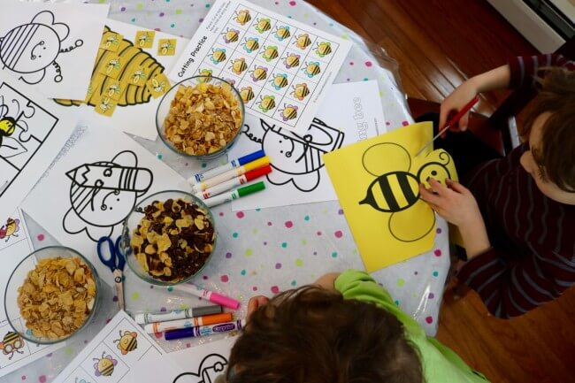 Kids enjoying a FREE 20 Page Fun Bee Activity Pack for Kids and Cereal Snacks