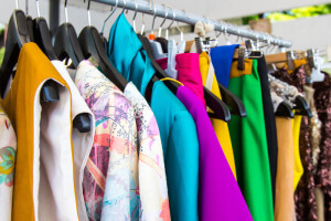 fashion clothing on hangers at the show
