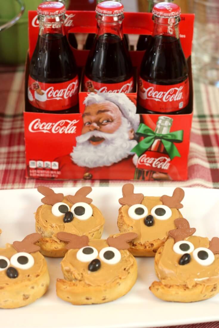Peanut butter frosted reindeer rolls and holiday inspired glas Coca-Cola bottles