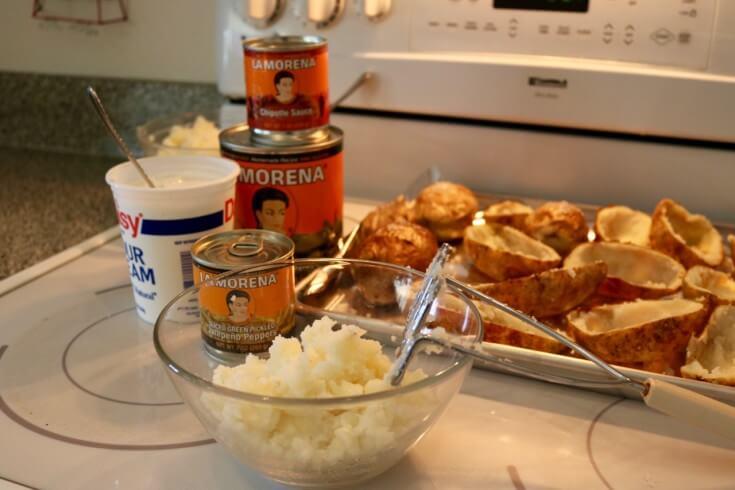 Mash the potatos to make LA MORENA® Jalapeño Popper Twice Baked Potatoes with adobo sauce